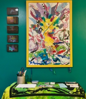 """My """"Ritual Tree"""" and a series of butterfly prints above the comment table."""